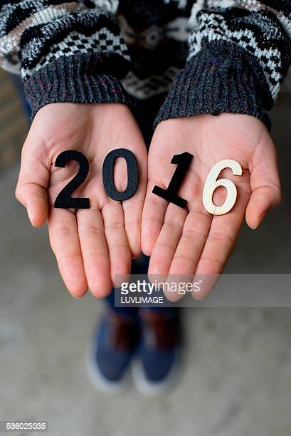 Hands holding 2016 ciphers