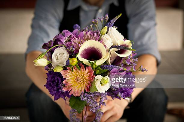 Hands Holding a Bouquet of Flowers