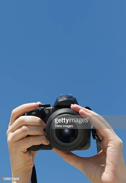 Hands holding a digital camera