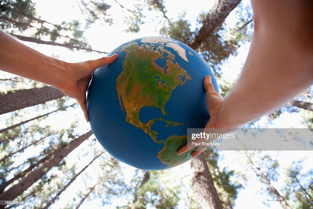 Hands holding a globe : Stock Photo