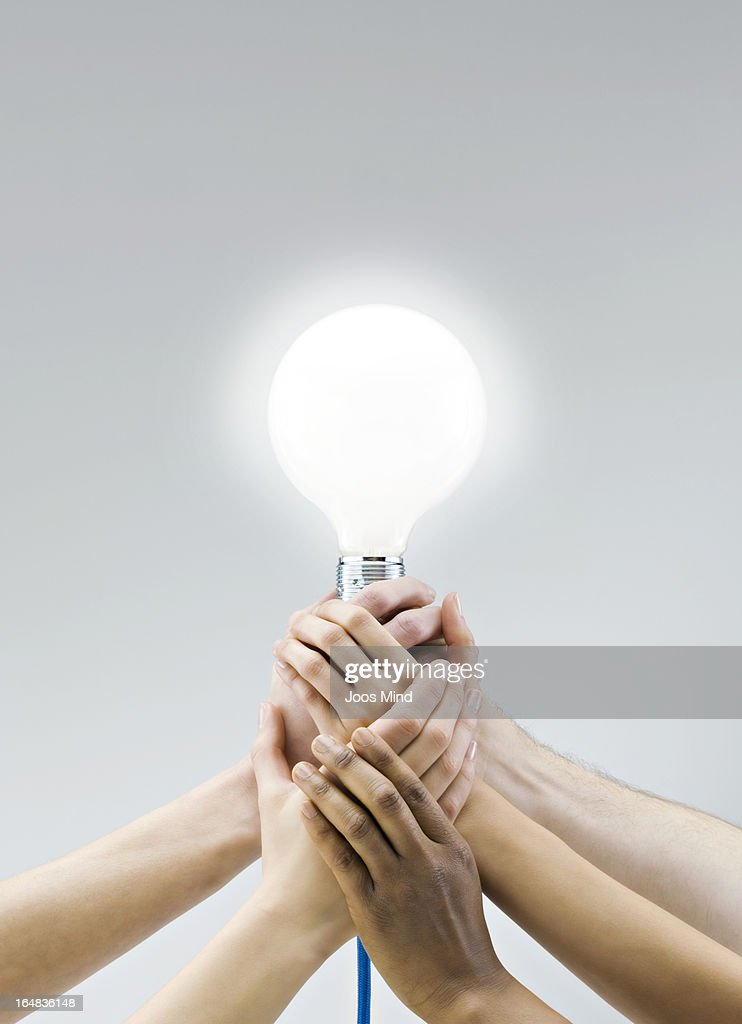 Hands holding a large light bulb : Photo