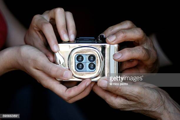 Hands holding a toy camera