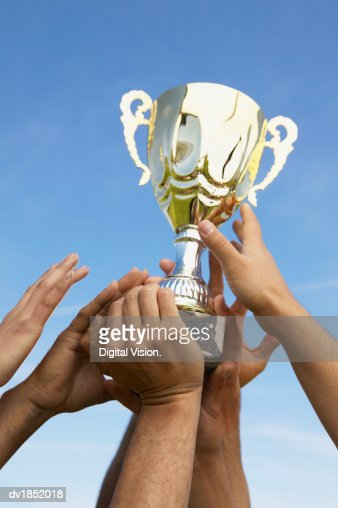Hands Holding a Trophy : Photo