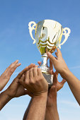 Hands Holding a Trophy