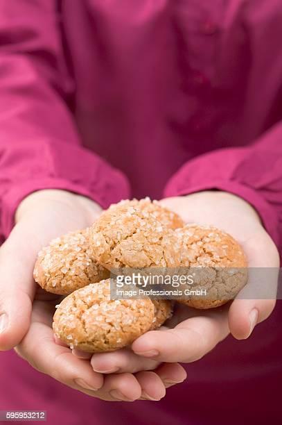 Hands holding amaretti