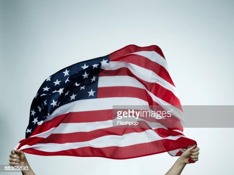 Hands holding American flag : Stock Photo