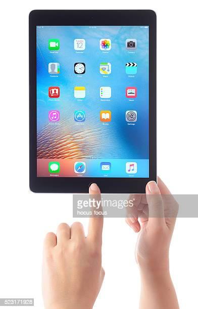 Hands holding Apple iPad Air