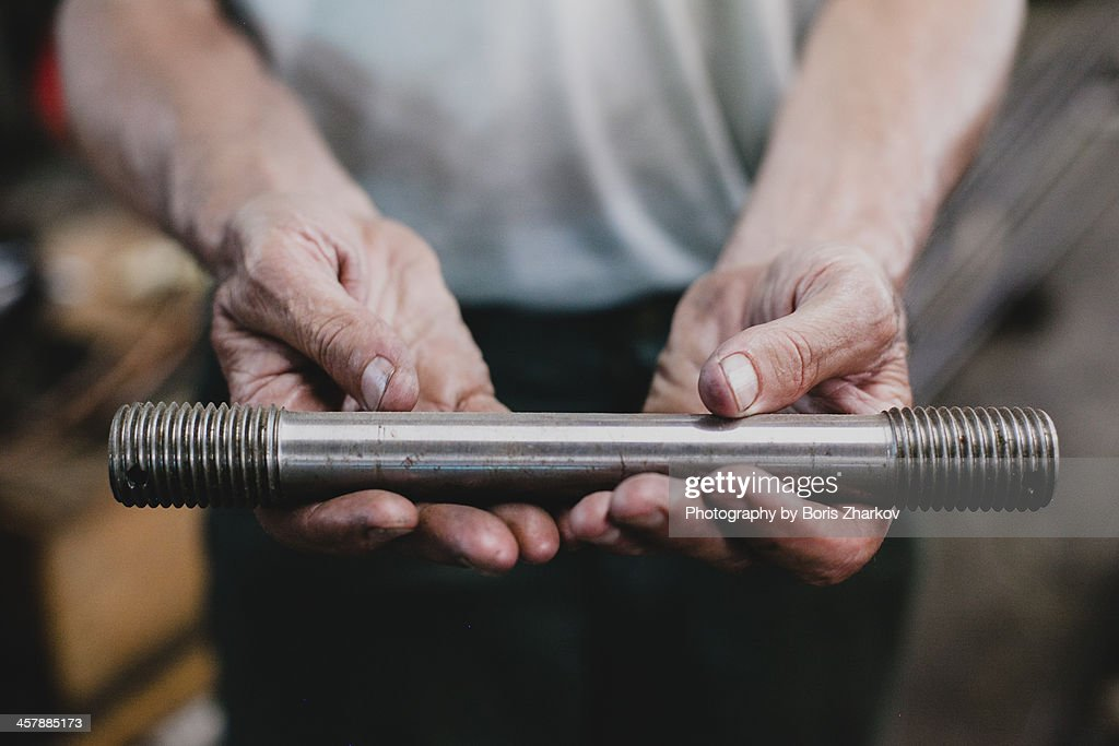 Hands holding assembly part