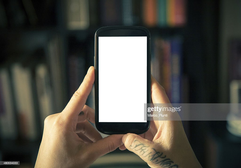 Hands holding blank smartphone : Stock Photo