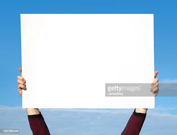 Hands Holding Blank White Sign in Sky