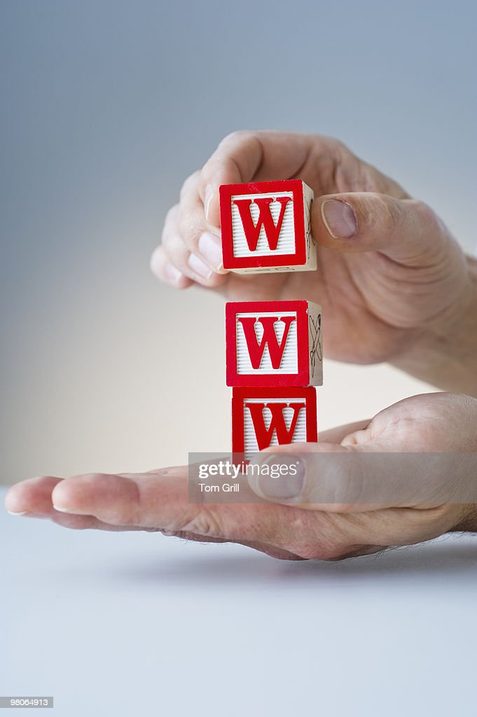 Hands holding block with WWW : Stock Photo
