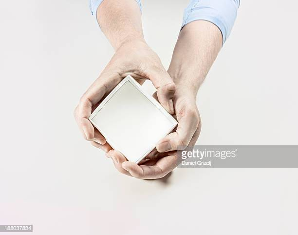 Hands holding box