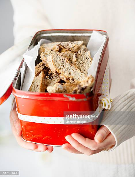 Hands holding box with bread