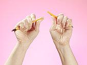 Hands holding broken pencil