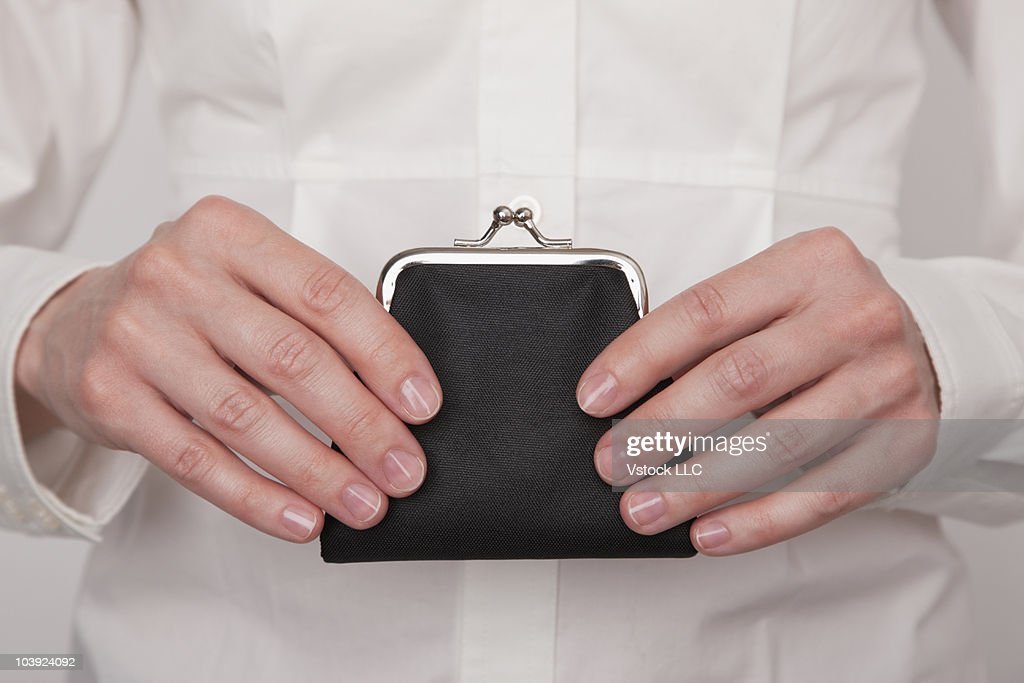 Hands holding change purse