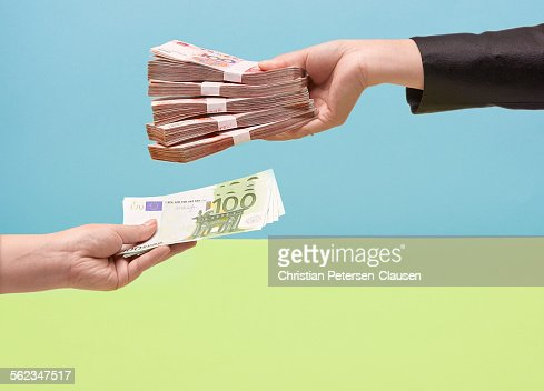 Hands holding Chinese RMB and european euros