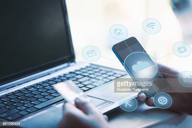 Hands holding credit card and using smart phone. Internet online shopping