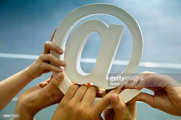 hands holding email symbol