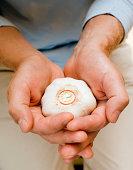 Hands holding garlic