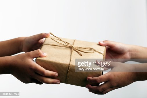 hands holding gift : Stock Photo