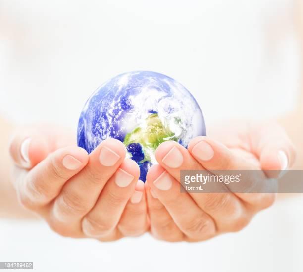 Hand Holding Globus
