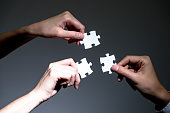 hands holding jigsaw puzzles, business to business, business matching concept