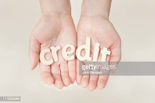 hands holding letters spelling words