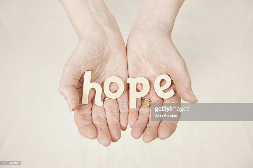 hands holding letters spelling words : Stock Photo