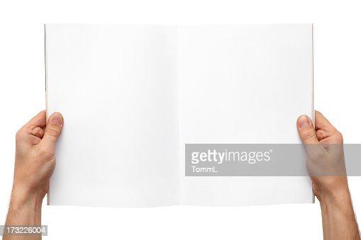 Hands holding magazine