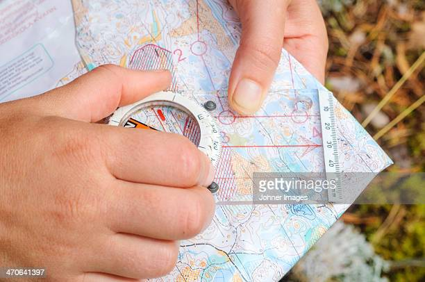 Hands holding map and compass