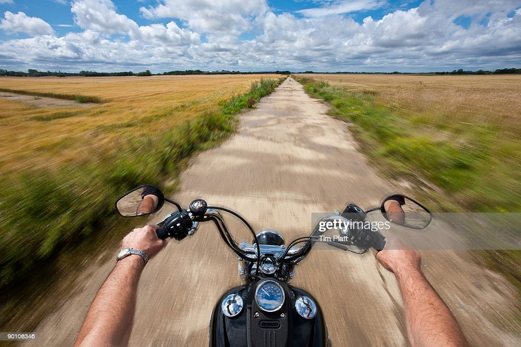 Hands holding motorcycle handlebars. : Stock Photo
