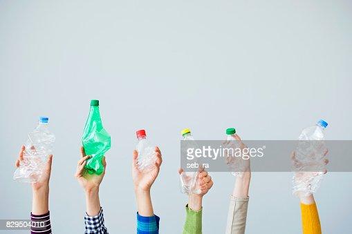 Hands holding plastic bottle : Stock Photo