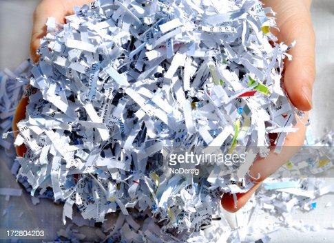 Hands holding shredded paper