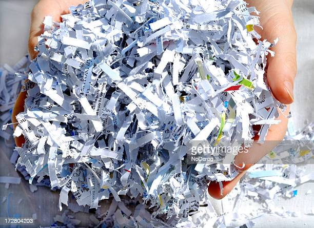 Hands holding shredded paper