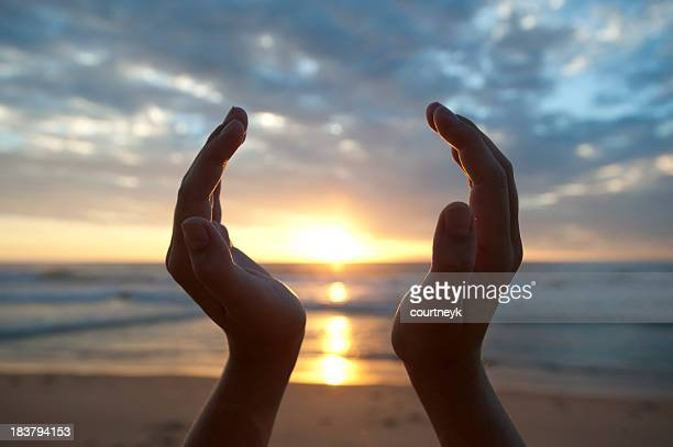 Hands holding the sunrise