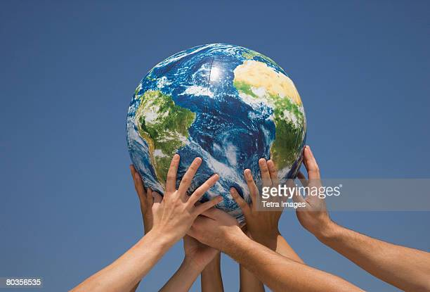 Hands holding up globe