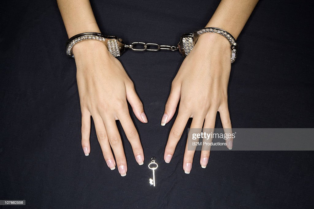 Hands in handcuffs Pleading : Stock Photo