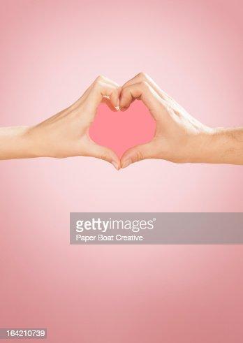 Hands making heart shape in studio : Stock Photo