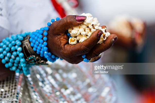 Hands of a Baiana woman seen during the popcorn bath an AfroBrazilian spiritual cleansing ritual performed in front of the St Lazarus church on...