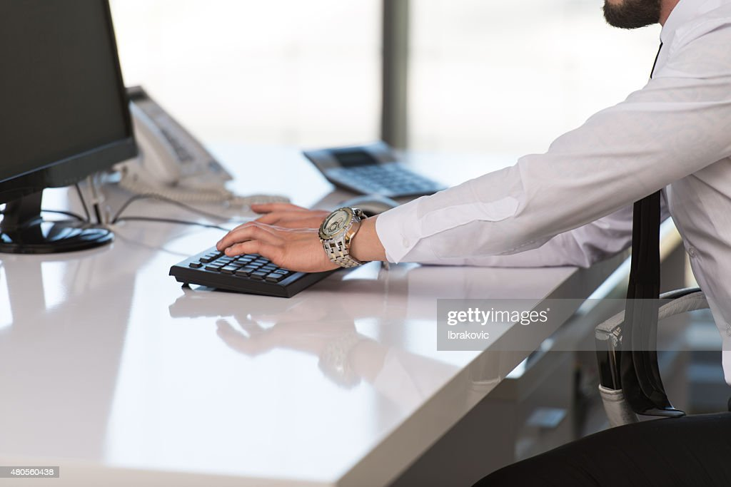 Hands Of A Businessman Using Computer : Stock Photo