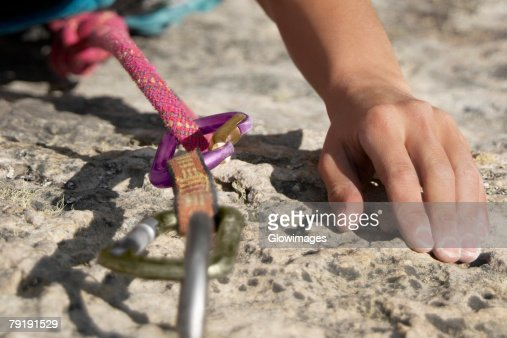 Hands of a rock climber gripping a rock : Stock Photo