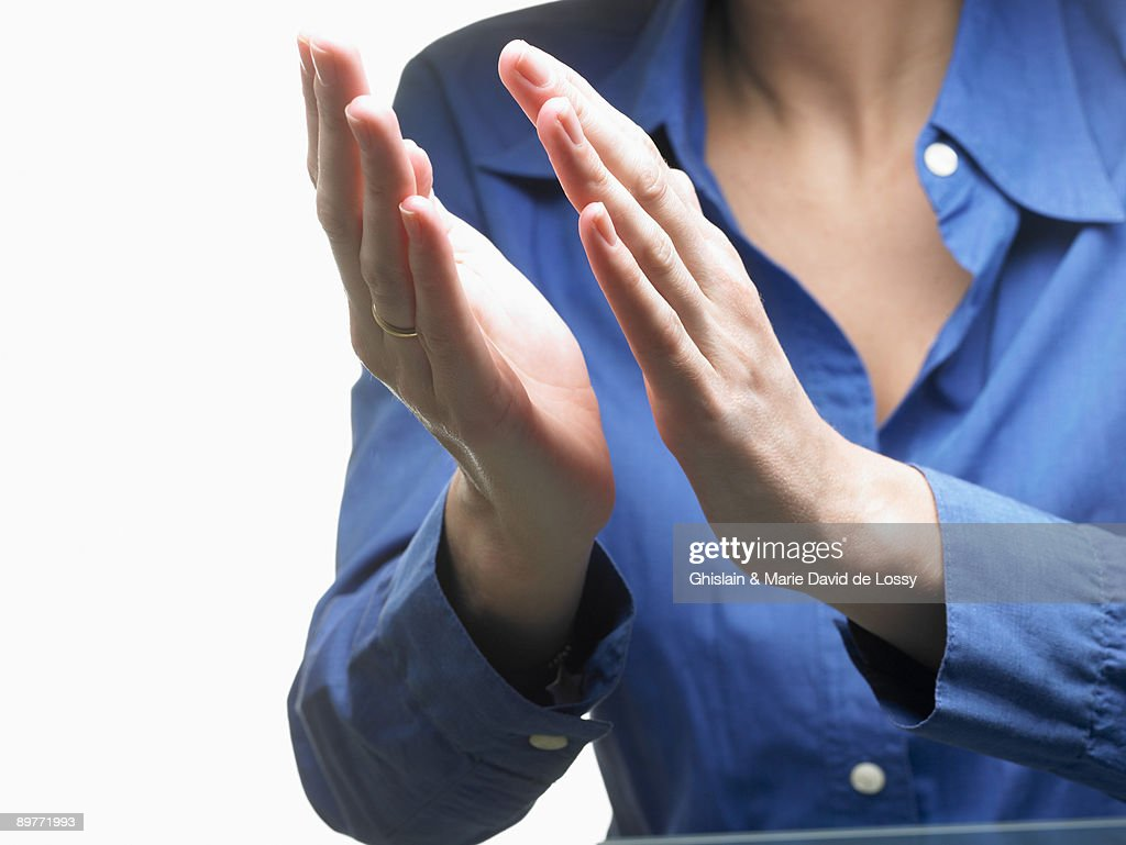 Hands of a woman, applauding