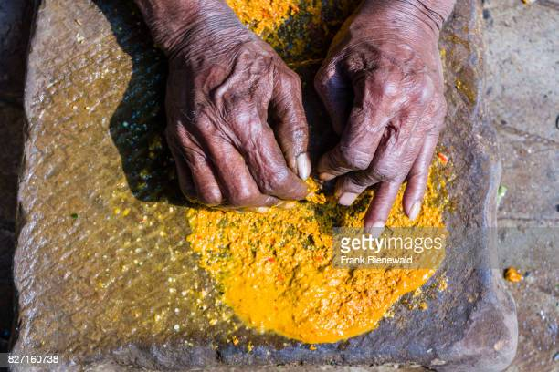 Hands of a woman grinding spices