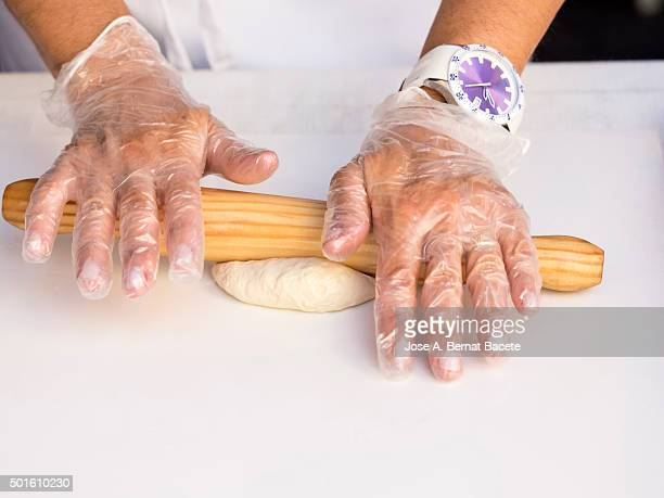 Hands of a woman kneading it grazes