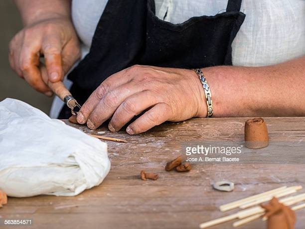Hands of a woman modeling clay
