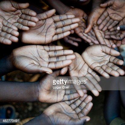 Hands of African children, need help.