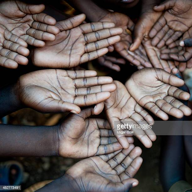 Hands of African children, need help.