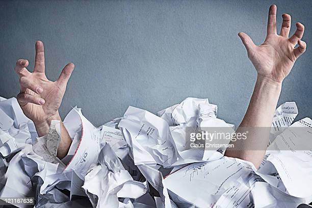 hands of aman drowning on paper work