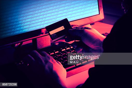 Hands of anonymous hacker : Stock Photo