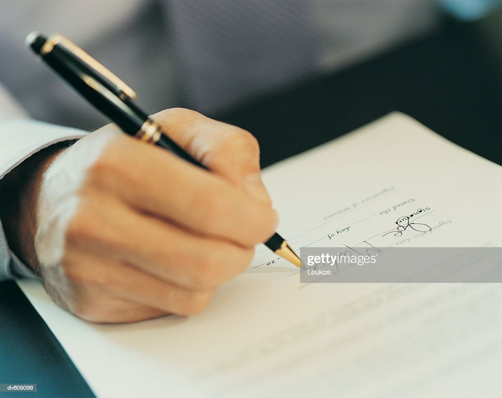 Hands of Businessman Signing Letter : Stock Photo